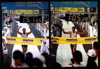 Coach Barry (L) and Tony Pauly finishing Ironman Korea, 2001